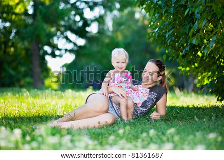 Baby and mother playing in the park