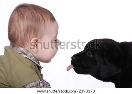 Baby and puppy - stock photo