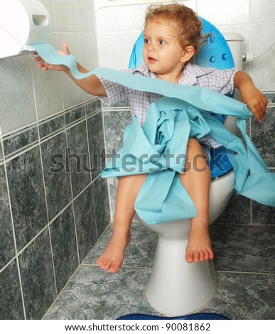Baby and toilet - stock photo