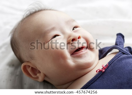 Baby Asian.Happy, cheerful excited expression
