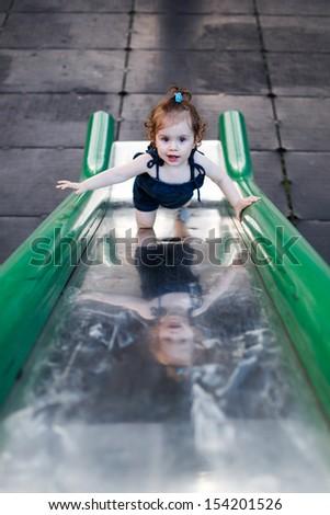 Baby at playground - Climb - stock photo