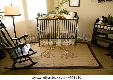 Baby bedroom with a crib, toys and decor.