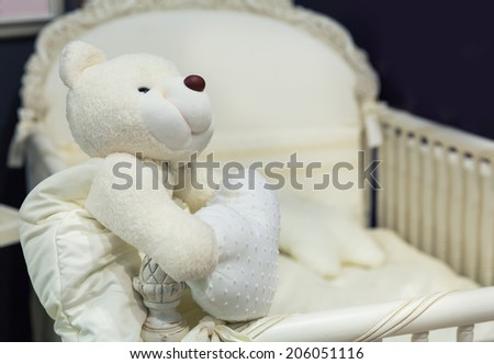 Baby bedroom with white teddy bear - stock photo