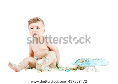 baby birthday boy with a smashed cake - stock photo