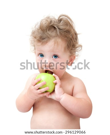 baby biting a green Apple on white background - stock photo