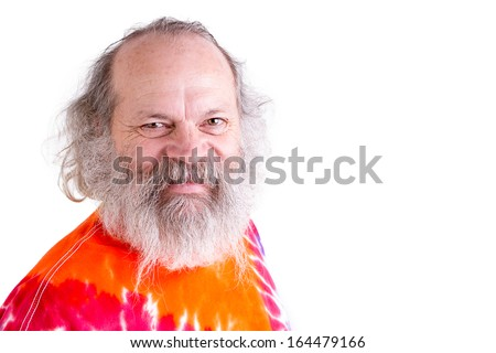 Baby boomer generation senior male smiling at you with his grey hair and long beard - stock photo