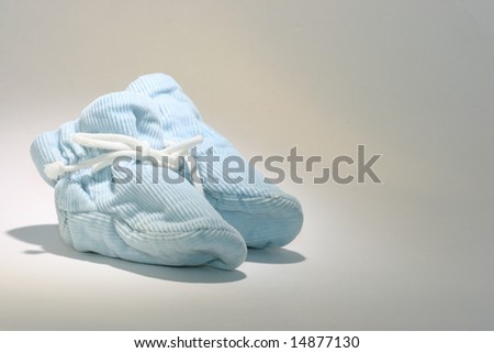 baby booties in spotlight - stock photo