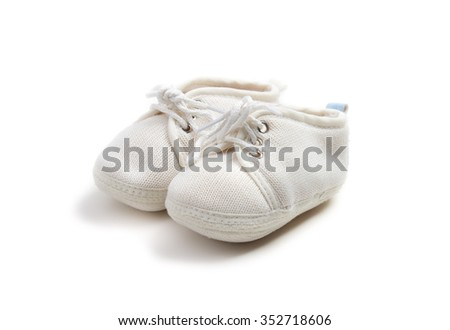 baby booties on a white background - stock photo