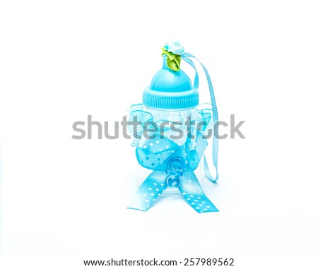 baby bottle and toy baby bad - stock photo