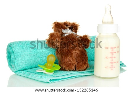 Baby bottle of milk with teddy bear  isolated on white - stock photo