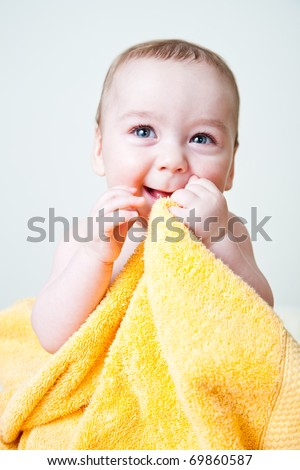 Baby Boy After Bath Wrapped in Yellow Towel Sitting and Posing