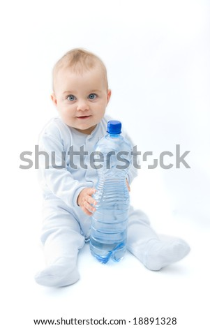 baby boy and bottle of mineral water, on white - stock photo