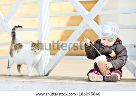 baby boy and cat on the walk - stock photo