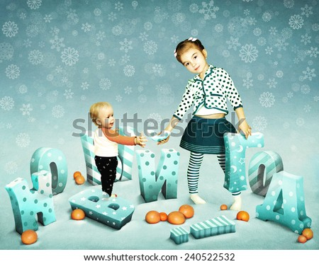 Baby Boy and girl with the letters of the New Year - stock photo