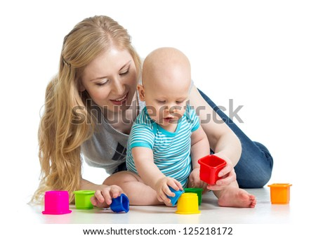 baby boy and mother playing together with colorful toys - stock photo