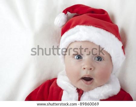 Baby boy as Santa Claus - stock photo