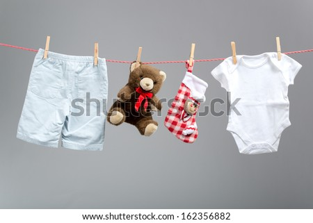 Baby boy clothes with santa bags  on the clothesline - stock photo