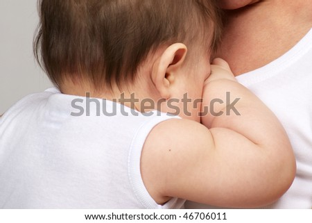 baby boy crying in mother arm - stock photo