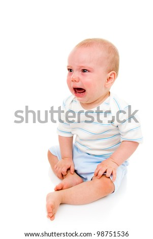 Baby boy, crying (8 months old) (he was super happy again a moment later!). - stock photo