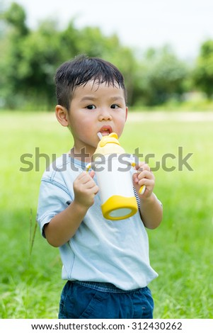 Baby boy drink water - stock photo