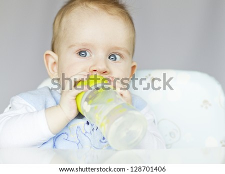 baby boy drinking water from bottle