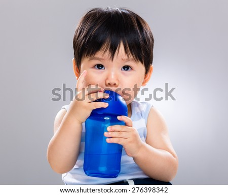 Baby boy drinking with water bottle - stock photo