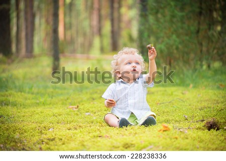 Baby boy exploring nature - stock photo