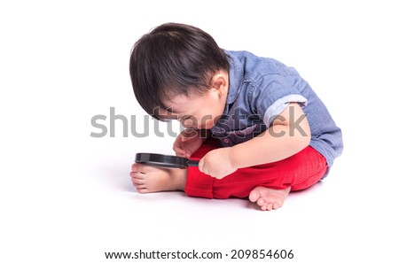 Baby boy exploring with the magnifying Isolated on the White Background - stock photo