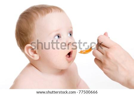 baby boy  feeding isolated on white - stock photo