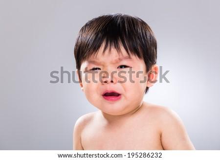 Baby boy feeling hungry - stock photo