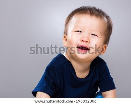 Baby boy feeling so happy - stock photo