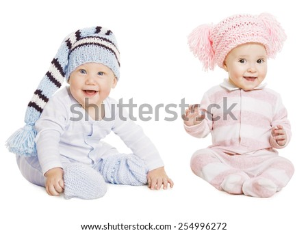Baby Boy Girl Portrait, Little Kids In Woolen Hat, Happy Children in Crawlers Creepers Wearing, Sitting Isolated Over White Background - stock photo
