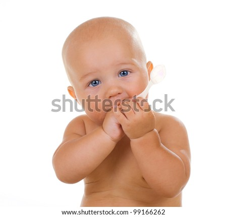 Baby boy holding a spoon on a white background - stock photo