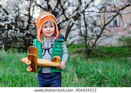 baby boy holding a toy airplane in hands - stock photo