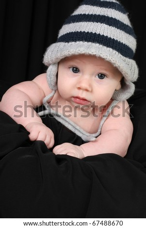 Baby boy in a knitted hat. - stock photo