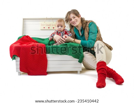 Baby boy in old box with his mother on white background - stock photo