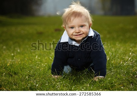 Baby boy in park - stock photo