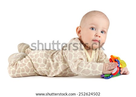 Baby boy is looking into the camera with a toy in hands on white background. - stock photo