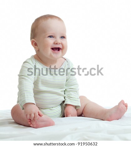 Baby boy isolated sitting smilingly - stock photo