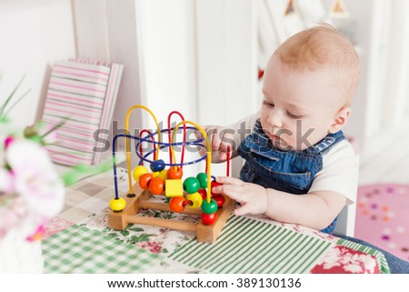baby boy kid playing with educational toy maze - stock photo
