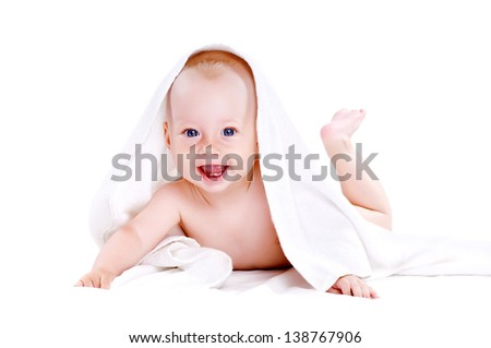 Baby boy lying under the white towel isolated on white background happy laughing