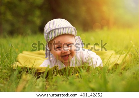 baby boy on the grass - stock photo