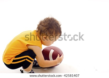 Baby Boy Pickup the  Football a lot of Copyspace - Isolated over a white background - stock photo