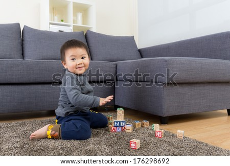 Baby boy play toy block - stock photo