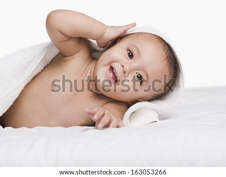 Baby boy playing with a towel - stock photo