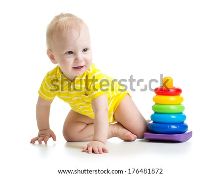 baby boy playing with educational toy - stock photo