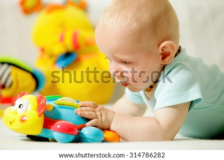 Baby boy playing with toy - stock photo