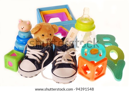 baby boy`s shoes with pregnancy ,teddy bear and toys isolated on white - stock photo