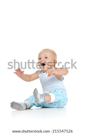 Baby boy sitting on a white background