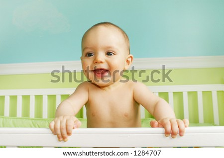 Baby Boy Smiling in crib - stock photo